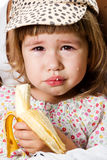 Girl eating a banana Stock Photo
