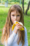 Girl are eating banana Royalty Free Stock Photo