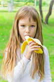 Girl are eating banana Stock Photo