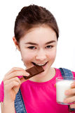 Girl eating bar of chocolate Stock Photo