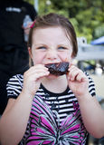 Girl eating bbq rib Royalty Free Stock Images