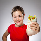 Girl eating big sandwich - focus on front Stock Photos