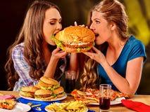 Girl eating big sandwich Royalty Free Stock Photo