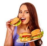 Girl eating big sandwich. Stock Images