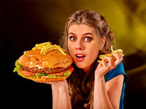 Girl eating big sandwich. Royalty Free Stock Photography