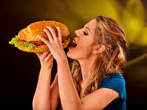 Girl eating big sandwich Royalty Free Stock Images