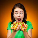 Girl eating big sandwiches Royalty Free Stock Photography