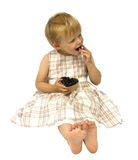 Girl eating bilberries Royalty Free Stock Photos
