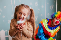Girl eating birthday cake. Royalty Free Stock Photos
