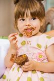 Girl Eating Birthday Cake With Icing On Her Face Stock Photography