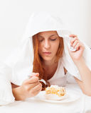 Girl eating biscuit in her bed Royalty Free Stock Photo