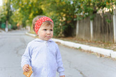 Girl eating Biscuit Royalty Free Stock Photos
