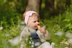 Girl Eating Bisquit Stock Photos
