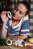 Girl eating boiled calamar Stock Images