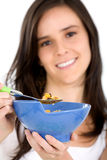 Girl eating breakfast Royalty Free Stock Photos