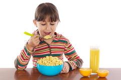 Girl eating breakfast Stock Photography