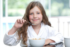 GIrl eating breakfast cereal Royalty Free Stock Photo