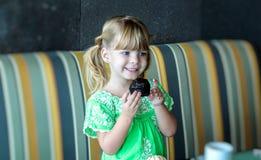 Girl eating breakfast Royalty Free Stock Photo