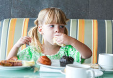 Girl eating breakfast Royalty Free Stock Image