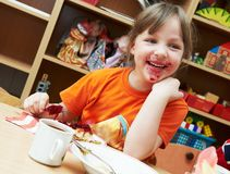 Girl eating breakfast Stock Images