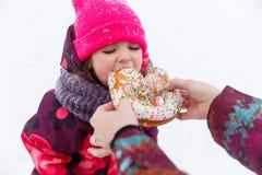 Girl eating bun at walk Royalty Free Stock Photo