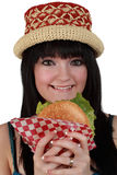 Girl eating a burger Stock Photography