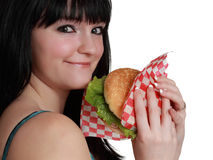 Girl eating a burger Royalty Free Stock Images