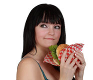 Girl eating a burger Royalty Free Stock Photo