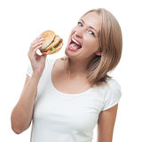 Girl eating burger isolated on white background Royalty Free Stock Photos