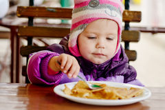 Girl eating in   cafe Stock Photos