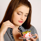Girl eating cake Royalty Free Stock Image