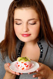 Girl eating cake Royalty Free Stock Photography