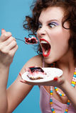 Girl eating cake Stock Photos