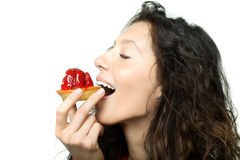 Girl eating a cake Stock Image