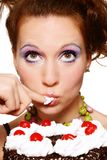 Girl eating cake Royalty Free Stock Photo