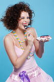Girl eating cake Stock Images