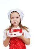 Girl eating cake Royalty Free Stock Images