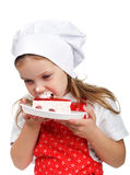 Girl eating cake Royalty Free Stock Photo