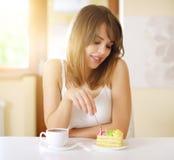 Girl eating cake Royalty Free Stock Photos