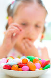 Girl eating candies Royalty Free Stock Image