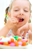 Girl eating candies Stock Image