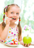 Girl eating candies Royalty Free Stock Images