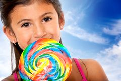 Girl eating candy Stock Photos