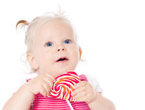 Girl eating candy Stock Image