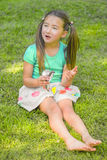 Girl Eating a Candy Bar Royalty Free Stock Image