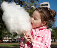 Girl eating candy-floss Royalty Free Stock Photo