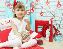 Girl eating candy Royalty Free Stock Images