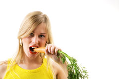 Girl eating carrot Stock Images