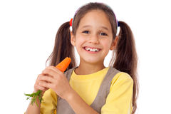 Girl eating the carrot Royalty Free Stock Photography