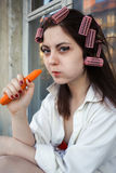 Girl eating carrot Royalty Free Stock Image